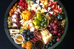 Fresh fruit paired with brie, cheeses, honey and jam